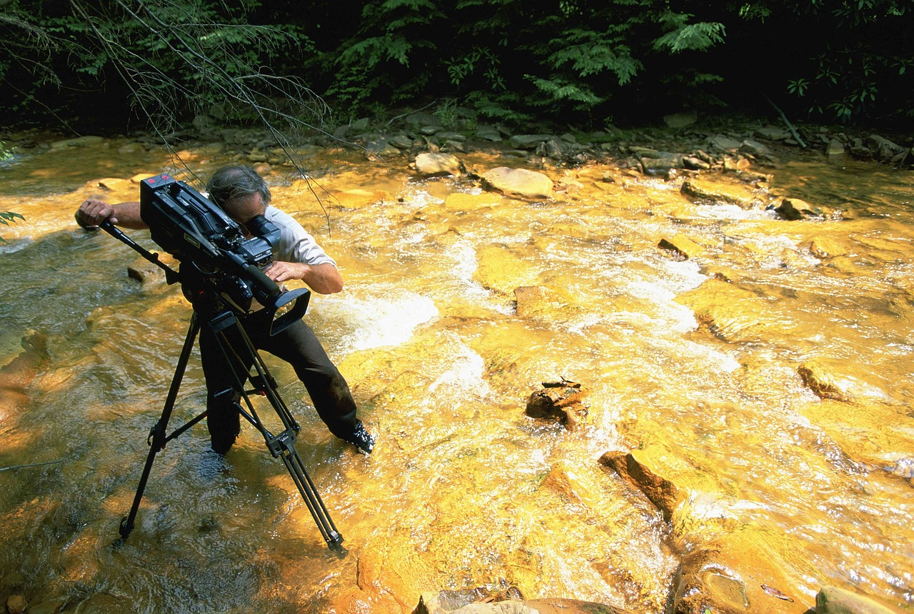 Videographer Shooting Water Stream in Toronto
